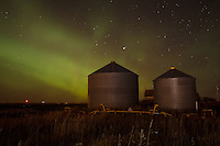 Early in the day I saw an alert that the Aurora Borealis would be active that night but it was cloudy and raining in Calgary at the time. I kept the idea in the back of my head aboout going out for a drive if it cleared up. It didn't look like it was going to happen until after midnight when all of a sudden the clouds around the city lifted. So I packed up my gear and headed east. The aurora got stronger and stronger the entire time I was out there and it seemed like that was going to continue all night. What an amazing thing to watch!<br /> <br /> &copy;2013, Sean Phillips<br /> http://www.RiverwoodPhotography.com