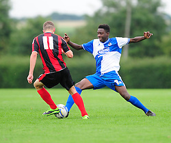 Bristol Rovers' U18s  Aaron Bryan makes a tackle - Photo mandatory by-line: Dougie Allward/JMP - Tel: Mobile: 07966 386802 17/08/2013 - SPORT - FOOTBALL - Bristol Rovers Training Ground - Friends Life Sports Ground - Bristol - Academy - Under 18s - Youth - Bristol Rovers U18s V Bournemouth U18s