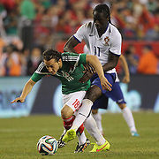 Andrés Guardado, Mexico, is fouled by Eder, Portugal, during the Portugal V Mexico International Friendly match in preparation for the 2014 FIFA World Cup in Brazil. Gillette Stadium, Boston (Foxborough), Massachusetts, USA. 6th June 2014. Photo Tim Clayton