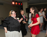 Jacquelyn Slavin and Bridget Eldridge hit the dance floor during Gilford High School's Senior Senior dance put on by the Student Council and Interact Club Wednesday evening.  (Karen Bobotas/for the Laconia Daily Sun)