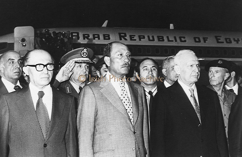 President Anwar Sadat (1918-1981) President of Egypt, centre, with the Israeli Prime Minister, Menachem Begin (1913-1992), at the start of his historic visit to Israel in 1977.
