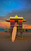 With a surfboard at dusk in Miami Beach's trendy South Beach is a Post-Modern lifeguard stand designed by architect William Lane.