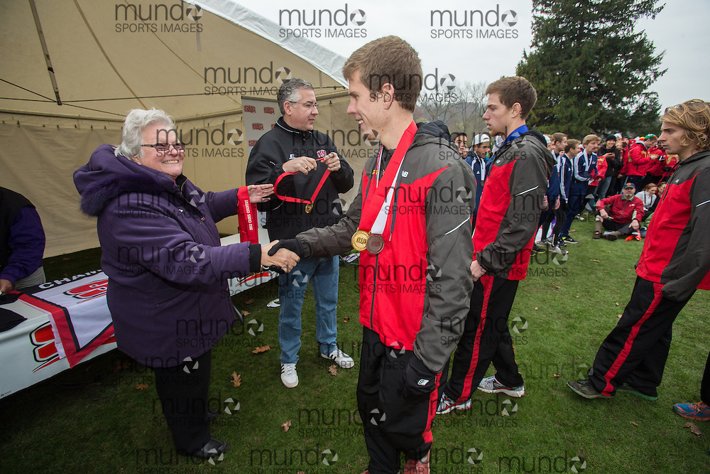London, Ontario ---2012-11-10--- The Guelph Gryphons Men's team receive their gold medals at the 2012 CIS Cross Country Championships at Thames Valley Golf Course in London, Ontario, November 10, 2012. .GEOFF ROBINS Mundo Sport Images