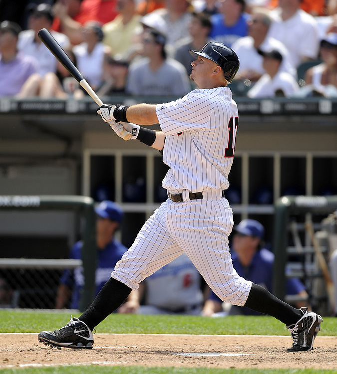 CHICAGO - JUNE 25:  A.J. Pierzynksi #12 of the Chicago White Sox watches the flight of his three run home run in the sixth inning against the Los Angeles Dodgers on June 25, 2009 at U.S. Cellular Field in Chicago, Illinois.  The White Sox defeated the Dodgers 6-5 in 13 innings.  (Photo by Ron Vesely)
