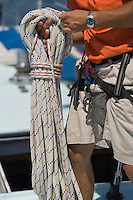 Sailor Holding Rope on yacht mid section