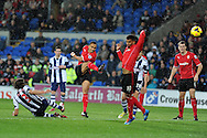 Cardiff city's Peter Odemwingie © hits a shot just wide of goal. Barclays Premier league, Cardiff city v West Bromwich Albion at the Cardiff city Stadium in Cardiff, South Wales on Saturday 14th Dec 2013. pic by Andrew Orchard, Andrew Orchard sports photography.