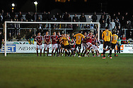 Wrexham players block a free-kick from Newport county's Andy Sandell (13). Blue Square Bet Premier division, Newport County FC v Wrexham at Rodney Parade in Newport, South Wales on Friday 4th Jan 2013. pic by Andrew Orchard, Andrew Orchard sports photography,