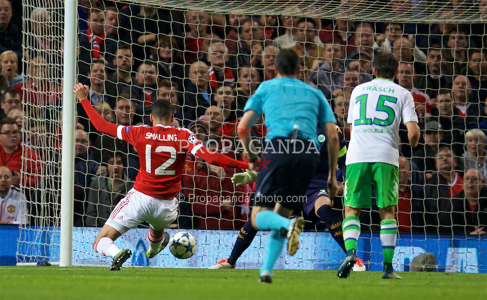 MANCHESTER, ENGLAND - Wednesday, September 30, 2015: Manchester United's Chris Smalling scores the second goal against VfL Wolfsburg during the UEFA Champions League Group B match at Old Trafford. (Pic by David Rawcliffe/Propaganda)