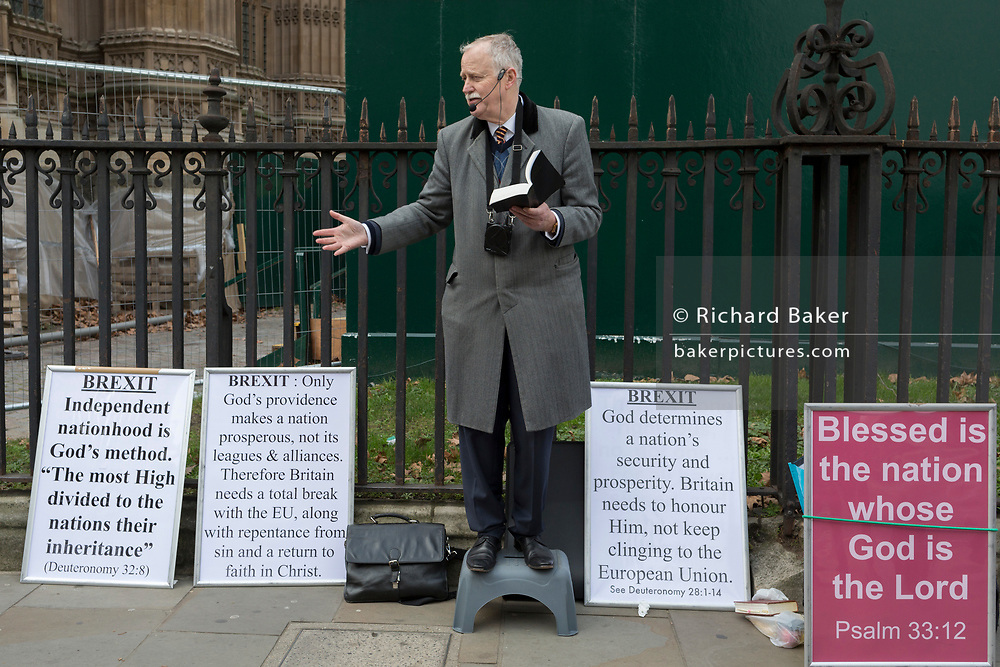 On the day that Prime Minister Theresa May's Meaningful Brexit vote is taken in the UK Parliament, a Christian preacher shouts out Brexit's context in the Bible, on 15th January 2019, in Westminster, London, England.