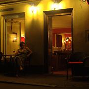 A woman sits outside a coffee shop in the street of Ljubljana, Slovenia.