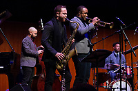 The 12th annual Hyde Park Jazz Festival was held this weekend, Saturday, September 29th and Sunday, September 30th, 2018 at various venues around Hyde Park. Jazz musicians from all around came out to play at the two-day event. <br /> <br /> 3121 &ndash; Mike Reed and his group performed &ldquo;The City Was Yellow: The Chicago Suite&rdquo; Saturday evening at the Reva and David Logan Center located at 915 E. 60th St.<br /> <br /> Please 'Like' &quot;Spencer Bibbs Photography&quot; on Facebook.<br /> <br /> Please leave a review for Spencer Bibbs Photography on Yelp.<br /> <br /> Please check me out on Twitter under Spencer Bibbs Photography.<br /> <br /> All rights to this photo are owned by Spencer Bibbs of Spencer Bibbs Photography and may only be used in any way shape or form, whole or in part with written permission by the owner of the photo, Spencer Bibbs.<br /> <br /> For all of your photography needs, please contact Spencer Bibbs at 773-895-4744. I can also be reached in the following ways:<br /> <br /> Website &ndash; www.spbdigitalconcepts.photoshelter.com<br /> <br /> Text - Text &ldquo;Spencer Bibbs&rdquo; to 72727<br /> <br /> Email &ndash; spencerbibbsphotography@yahoo.com<br /> <br /> #SpencerBibbsPhotography #HydePark #Community #Neighborhood<br /> #Music<br /> #HydeParkJazzFestival<br /> #Jazz<br /> #LiveMusic<br /> #MikeReed