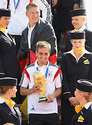 15.07.2014, Flughafen Tegel, Berlin, GER, FIFA WM, Empfang der Weltmeister in Deutschland, Finale, im Bild Philipp Lahm (GER) berlaesst mit dem WM-Pokal die Lufthansamaschine. // during Celebration of Team Germany for Champion of the FIFA Worldcup Brazil 2014 at the Flughafen Tegel in Berlin, Germany on 2014/07/15. EXPA Pictures © 2014, PhotoCredit: EXPA/ Eibner-Pressefoto/ Eibner Pressefoto / pool<br /> <br /> *****ATTENTION - OUT of GER*****
