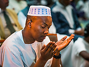 04 JUNE 2019 - DES MOINES, IOWA: A man prays during Eid al Fitr services in the Iowa Events Center in Des Moines Tuesday. About 3,000 people were expected to attend the annual community wide celebration of Eid al Fitr which marks the end of Ramadan, the Muslim month of fasting. According to the event organizers, there are about 15,000 Muslims in the Des Moines area.           PHOTO BY JACK KURTZ