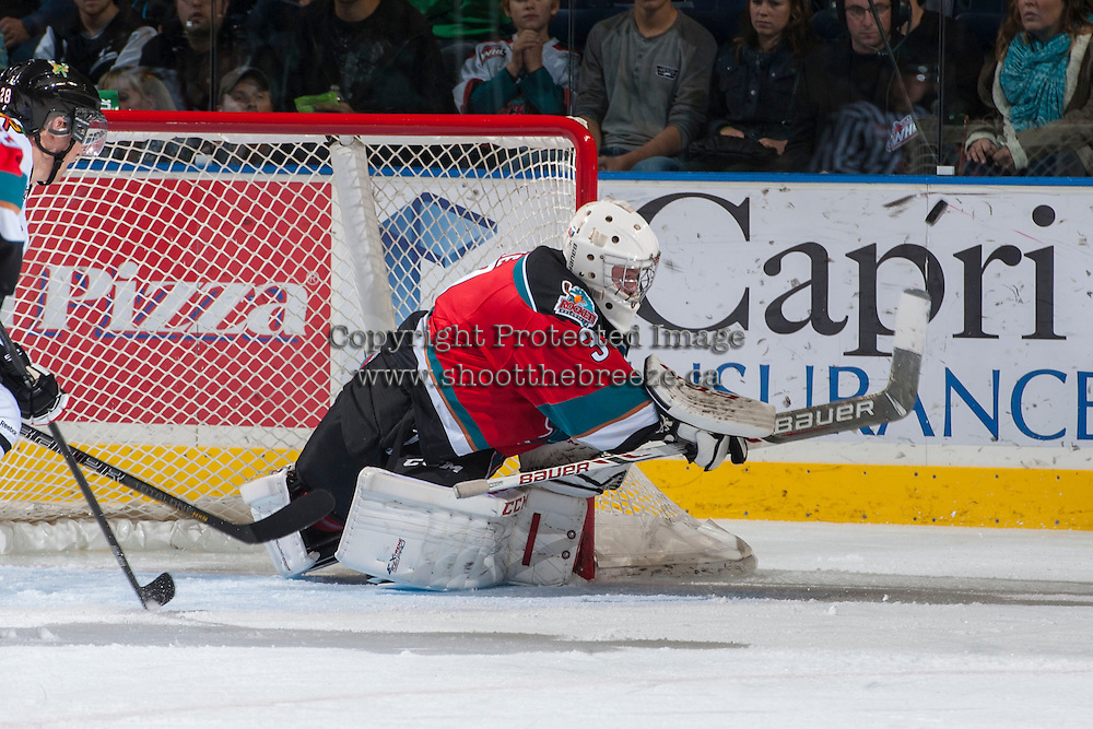 KELOWNA, CANADA - OCTOBER 5:   Jordon Cooke #30 of the Kelowna Rockets makes a poke check save against the Portland Winterhawks at the Kelowna Rockets on October 5, 2013 at Prospera Place in Kelowna, British Columbia, Canada (Photo by Marissa Baecker/Shoot the Breeze) *** Local Caption ***