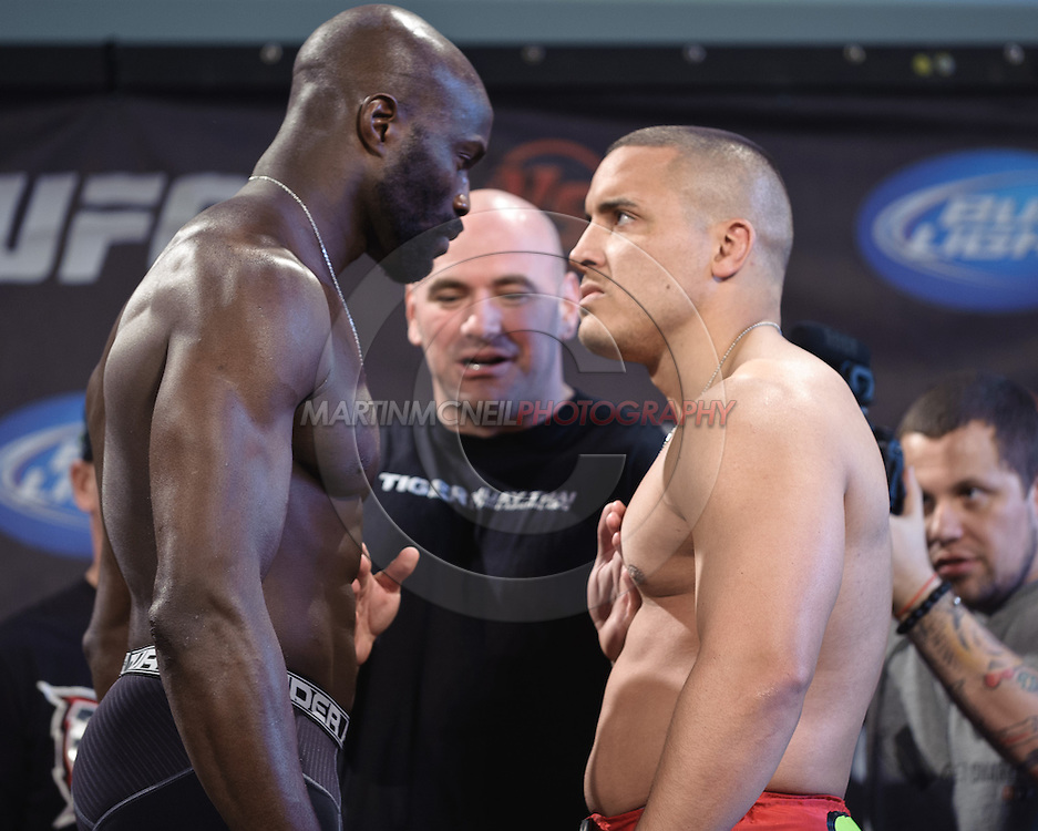 "PITTSBURGH, PENNSYLVANiA, JUNE 25, 2011: Cheick Kongo (left) faces off against opponent Pat Barry (right) during the official weigh-in for ""UFC on Versus 4: Kongo vs. Barry"" inside Heinz Field Cocz Cola Great Hall in Pittsburgh, Pennsylvania on June 25, 2011."