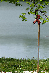28 May 2014:   A water pump stands near Dawson Lake in Moraine View State Park