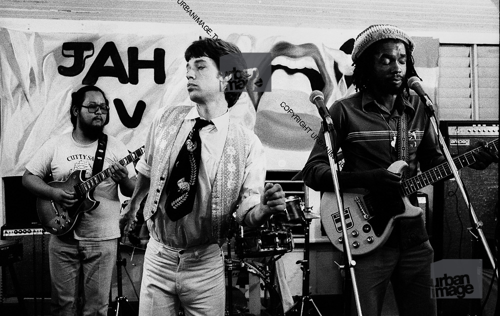 Peter Tosh. Sly and Robbie's Sly Dunbar  and the Rolling Stones during the Don't Look Back video shoot - Strawberry Hill Jamaica 1978.