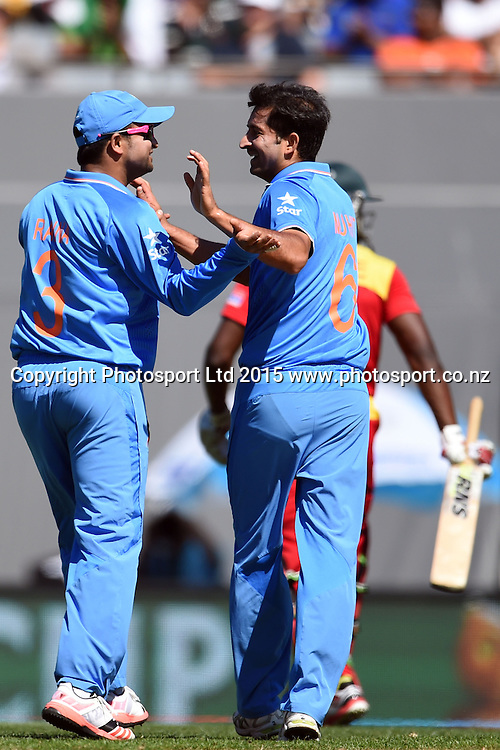 Indian players celebrate the wicket of Zimbabwe batsman Solomon Mire during the ICC Cricket World Cup match between India and Zimbabwe at Eden Park in Auckland, New Zealand. Saturday 14 March 2015. Copyright Photo: Raghavan Venugopal / www.photosport.co.nz