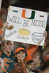 Fans hold up signs during the final Miami Hurricanes football game in the 70 year old Orange Bowl.  The #19 Virginia Cavaliers defeated the Miami Hurricanes 48-0 at the Orange Bowl in Miami, Florida on November 10, 2007.  The game was the final game played in the Orange Bowl.