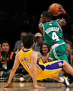 Sasha Vujacic is fouled by Nate Robinson in the first half. The Lakers defeated the Boston Celtics in game 6 of the NBA Finals 89-67. Los Angeles, CA 06/15/2010 (John McCoy/Staff Photographer).
