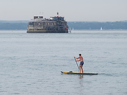 © Licensed to London News Pictures. 19/09/2016. Portsmouth, UK.  A man on a paddle board making the most of the calm sea conditions off Southsea this morning, 19th September 2016. The weather is set to be cloudy with sunny intervals in the south east of England. Photo credit: Rob Arnold/LNP