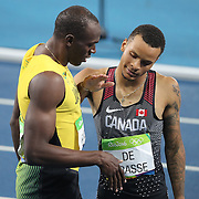 Athletics - Olympics: Day 13   Usain Bolt of Jamaica winning the gold medal in the Men's 200m Final is congratulated by Andre De Grasse of Canada who won the silver medal at the Olympic Stadium on August 18, 2016 in Rio de Janeiro, Brazil. (Photo by Tim Clayton/Corbis via Getty Images)