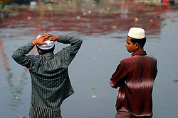 BANGLADESH TONGI 4FEB07 - Two Bangladeshi boys enjoy a quiet moment during the last day of the BiswaIjtema outside Tongi, a northern suburb of the capital city Dhaka. The annual Tablighi Jamaat Islamic movement congregation lasts three days and is attended by over two million Muslims, making it the second largest congregation after the Hajj to Mecca. Devotees from approximately 80 countries, including the host country, Bangladesh, attend the three-day Ijtema seeking divine blessings from Allah. The event focuses on prayers and meditation and does not allow political discussion. The local police estimated the number of attendees of the 2007 Ijtema to be 3 million...jre/Photo by Jiri Rezac..© Jiri Rezac 2007..Contact: +44 (0) 7050 110 417.Mobile:  +44 (0) 7801 337 683.Office:  +44 (0) 20 8968 9635..Email:   jiri@jirirezac.com.Web:    www.jirirezac.com..© All images Jiri Rezac 2007 - All rights reserved.