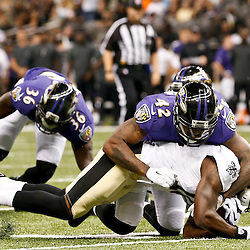 Aug 28, 2014; New Orleans, LA, USA; New Orleans Saints wide receiver Brandin Cooks (10) is tackled by Baltimore Ravens defensive back Dominique Franks (42) during the first half of a preseason game at Mercedes-Benz Superdome. The Ravens defeated the Saints 22-13. Mandatory Credit: Derick E. Hingle-USA TODAY Sports