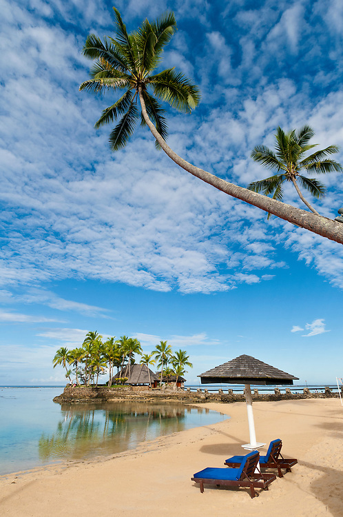 Beach, palm trees and Wicked Walu Restaurant at Warwick Fiji Resort & Spa, Coral Coast, Viti Levu Island, Fiji.