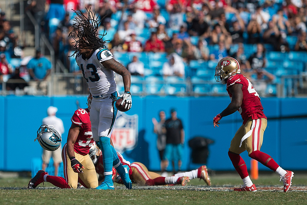Carolina's Kelvin Benjamin (13) celebrates as his helmet falls off after catching a pass in traffic.  <br /> San Francisco 49ers vs Carolina Panthers at Bank of America Stadium in Charlotte, N.C., on Sunday, Sept. 18, 2016. <br /> Zach Bland/For Auburn Athletics
