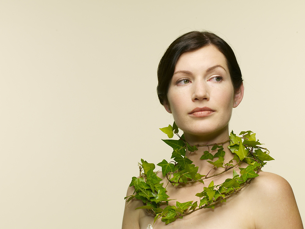 Portrait or young woman 28-30 yo, with ivy around neck.