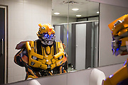 UNITED KINGDOM, London: 23 October 2015. <br /> Comic Con Feature.<br /> A cosplay fan dressed as a Transformer inspects himself in the mirror during the convention.<br /> Photo: Rick Findler / Story Picture Agency