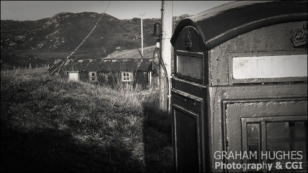 Corrugated Metal Hut in field on Isle Of Lewis, Scotland. Phone box in foreground.