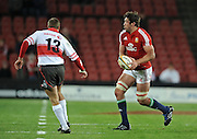 Lock of the British & Irish Lions, Nathan Hines passes the ball with Jannie Boshoff of the Xerox Lions watching him.<br /> Rugby - 090602 - British&Irish Lions v Xerox Lions - Coca-Cola Park - Johannesburg - South Africa.<br /> Photographer : Anton de Villiers / SASPA