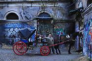 Roma, 19/01/2011: le carrozzelle lasciano le stalle del Campo Boario per recarsi a lavoro nei luoghi turistici del Centro Storico - horses coaches leave stables in Campo Boario