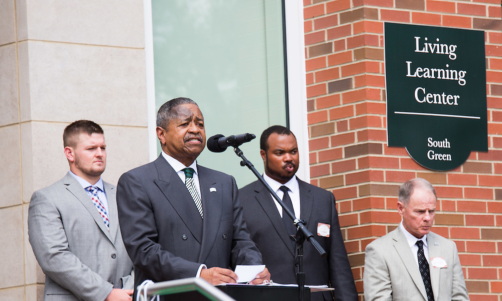 President McDavis speaks before the ribbon cutting ceremony for the new residential hall grand opening on Sat. August 29, 2015.