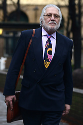 © Licensed to London News Pictures.17/01/2014. London, UK Radio One DJ, Dave Lee Travis (David Patrick Griffin) arrives at Southwark Crown Court. Travis is appearing in court, after being arrested at his home by the Metropolitan Police as part of Operation Yewtree, due to alleged sexual assaults during the 1970's and 80's during his time at the BBC. Photo credit : Peter Kollanyi/LNP