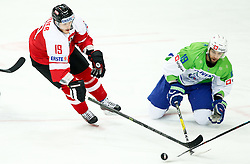 Stefan Geier of Austria vs Ziga Pance of Slovenia in action during ice hockey match between National Teams of Austria and Slovenia in 5th Round of 2016 IIHF Ice Hockey World Championship Division 1 - Group A, on April 29, 2016 in Spodek Arena, Katowice, Poland. Photo by Marek Piuyzs / Sportida