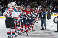 KELOWNA, CANADA - MARCH 28: The Tri-City Americans and the Kelowna Rockets shake hands on March 28, 2014 after the Kelowna Rockets win game 5 of the first round of WHL Playoffs and end the series with a 4-1 win at Prospera Place in Kelowna, British Columbia, Canada.   (Photo by Marissa Baecker/Getty Images)  *** Local Caption ***