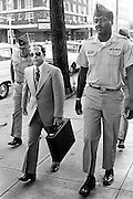 "Convicted of the murder of 102 VietNamese civilians  -the My Lai Massacre - former U.S. Army Lieutenant William Calley (sunglasses) is escorted from the Fort Benning, Georgia confinement facility to a federal appeals court in nearby Columbus, Ga. At a later date, Calley's original sentence of life in prison was turned into an order of house arrest, but after three years, President Richard Nixon reduced his sentence with a presidential pardon -- Determine pricing and license this image, simply by clicking ""Add To Cart"" below --"