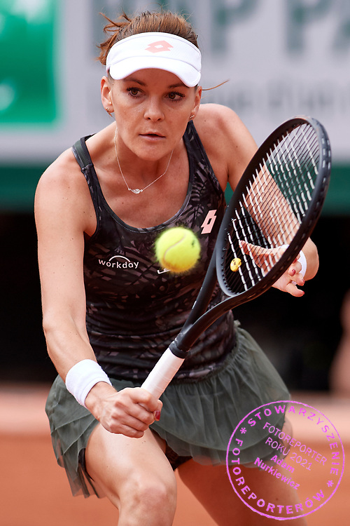 Paris, France - 2017 June 03: Agnieszka Radwanska from Poland plays a backhand during her women's single match third round  during tennis Grand Slam tournament The French Open 2017 (also called Roland Garros) at Stade Roland Garros on June 03, 2017 in Paris, France.<br /> <br /> Mandatory credit:<br /> Photo by &copy; Adam Nurkiewicz<br /> <br /> Adam Nurkiewicz declares that he has no rights to the image of people at the photographs of his authorship.<br /> <br /> Picture also available in RAW (NEF) or TIFF format on special request.<br /> <br /> Any editorial, commercial or promotional use requires written permission from the author of image.