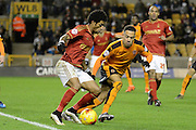 Nottingham Forest striker Ryan Mendes takes on Wolverhampton Wanderers midfielder Jordan Graham during the Sky Bet Championship match between Wolverhampton Wanderers and Nottingham Forest at Molineux, Wolverhampton, England on 11 December 2015. Photo by Alan Franklin.