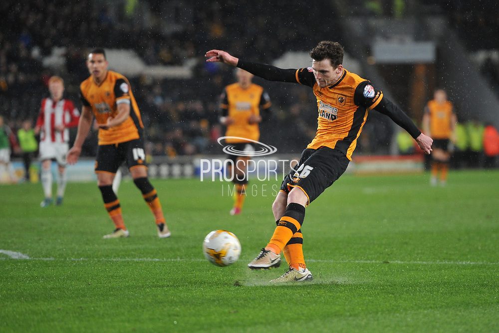 Hull City defender Andrew Robertson (26)  kicks towards goal during the Sky Bet Championship match between Hull City and Brentford at the KC Stadium, Kingston upon Hull, England on 26 April 2016. Photo by Ian Lyall.