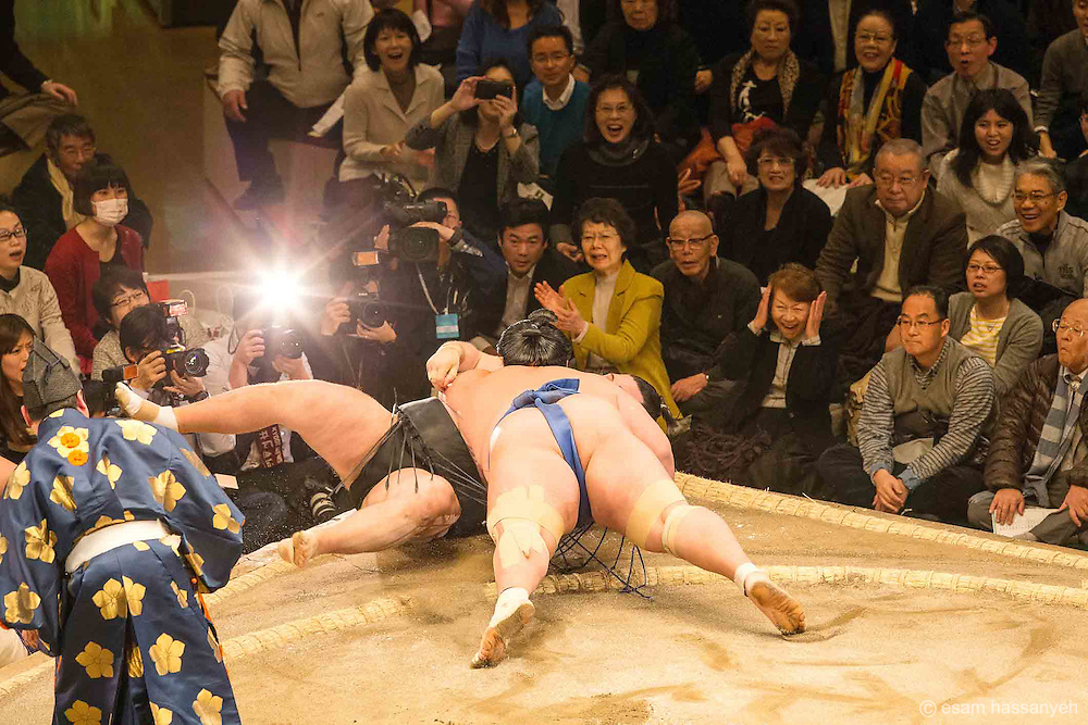 Sumo wrestlers compete at the Ryōgoku Kokugikan in Tokyo during the grand tournament