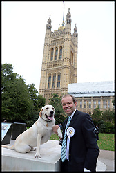 David Burrowes and his dog Cholmeley take part in the Westminster Dog of the Year 2013 with his dog Noodle. London, United Kingdom. Thursday, 10th October 2013. Picture by Andrew Parsons / i-Images