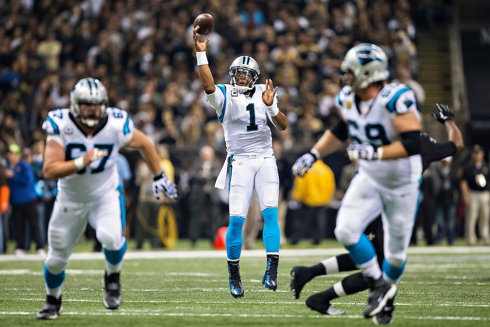 NEW ORLEANS, LA - DECEMBER 8:  Cam Newton #1 of the Carolina Panthers throws a pass against the New Orleans Saints at Mercedes-Benz Superdome on December 8, 2013 in New Orleans, Louisiana.  The Saints defeated the Panthers 31-13.  (Photo by Wesley Hitt/Getty Images) *** Local Caption *** Cam Newton
