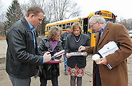 Cedar Rapids Recreation Superintendent Sven Leff (from left) and City Council members Ann Poe, Monica Vernon and Scott Olson look at property maps at the site of the former Time Check Recreation Center as members of the Northwest Recreation Center Task Force take a bus tour of the five possible sites for a new recreation center in Cedar Rapids on Thursday morning, February 23, 2012. (Stephen Mally/Freelance)