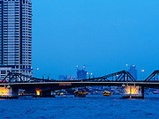 18 FEBRUARY 2015 - BANGKOK, THAILAND: The Chao Phraya River as seen from the Kudeejeen neighborhood in Bangkok. Santa Cruz church was established in 1770  and is one of the oldest and most historic Catholic churches in Thailand. The church was originally built by Portuguese soldiers allied with King Taksin the Great. Taksin authorized the church as a thanks to the Portuguese who assisted the Siamese during the war with Burma. Most of the Catholics in the neighborhood trace their family roots to the original Portuguese soldiers who married Siamese (Thai) women. There are about 300,000 Catholics in Thailand in about 430 Catholic parishes and about 660 Catholic priests in Thailand. Thais are tolerant of other religions and although Thailand is officially Buddhist, Catholics are allowed to freely practice and people who convert to Catholicism are not discriminated against.        PHOTO BY JACK KURTZ