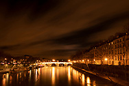 A night time view of the Pont Marie, the Il St Louis and reflections on the Seine. Paris, France, Europe