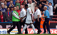Photo: Alan Crowhurst.<br />Crystal Palace v Preston NE. Coca Cola Championship.<br />24/09/2005. Preston's Claude Davis is escorted from the pitch after being sent off.